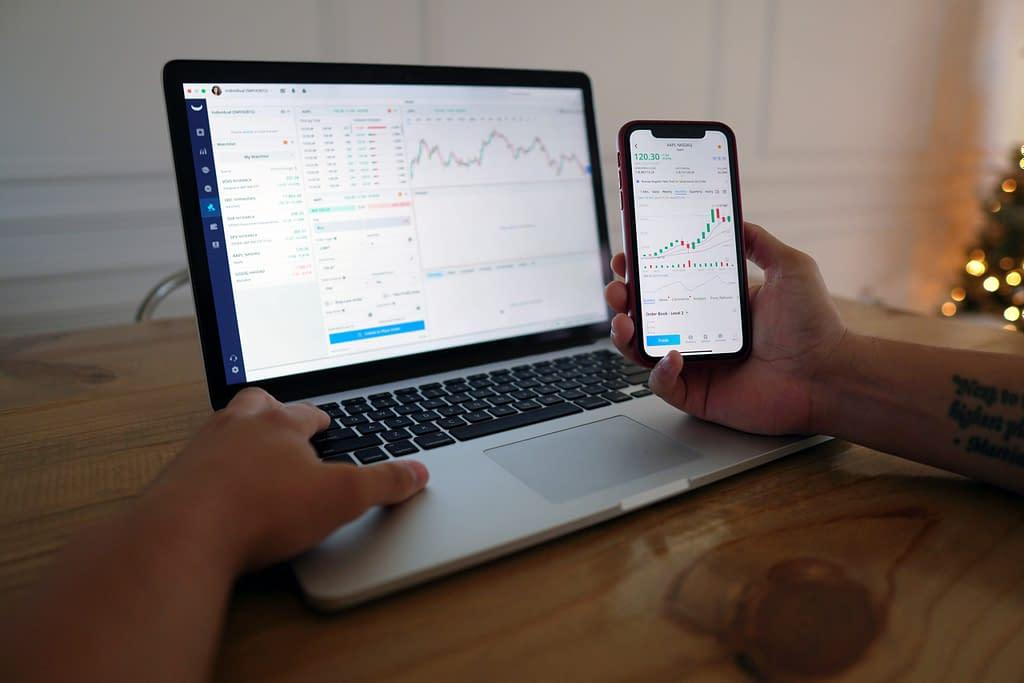 man, computer, stock trading