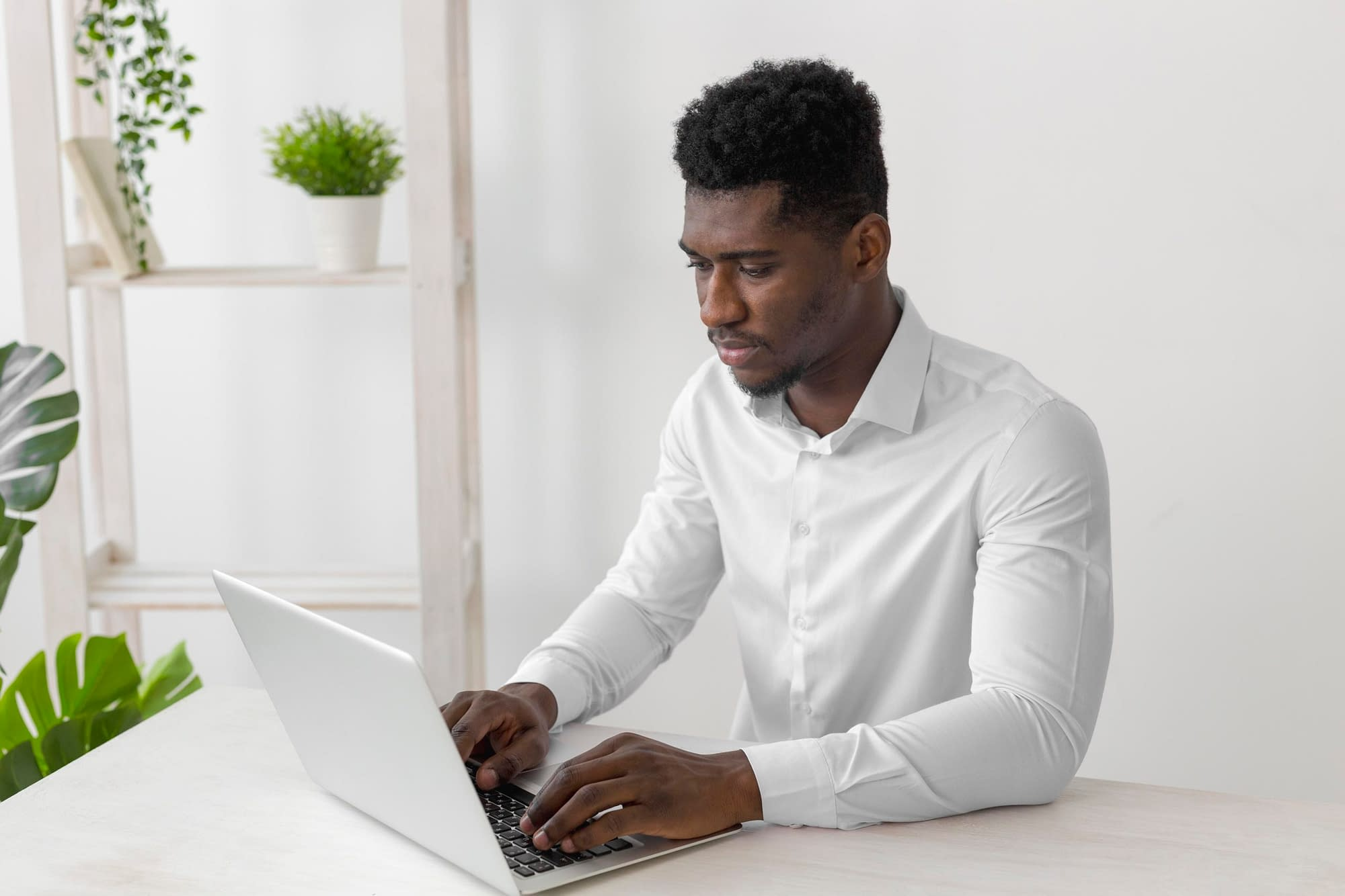 african american man working laptop scaled