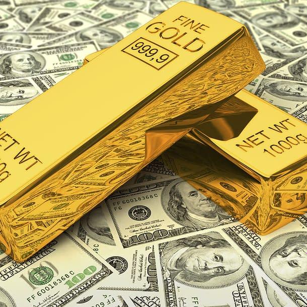 gold-bars-on-dollars